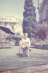 Belle Miller seated in Blackburn Gardens