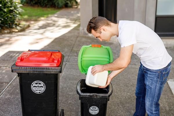 male placing scraps into small bin