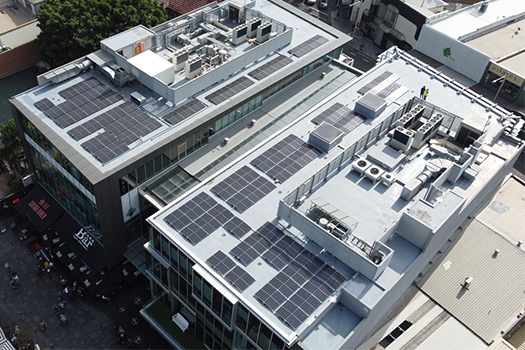 Drone image of the solar panels on the roof with Kiaora Lane in the foreground