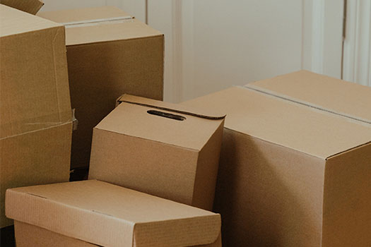 Cardboard boxes stacked together