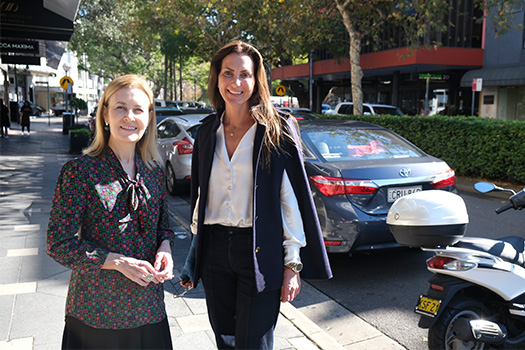 Gabrielle Upton and Mayor Susan Wynne standing on Knox St with shops, cafes and cars behind them