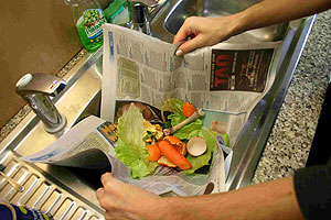 Wrapping food scraps in newspaper