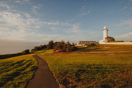Walking path with Macquarie Lighthouse in the background