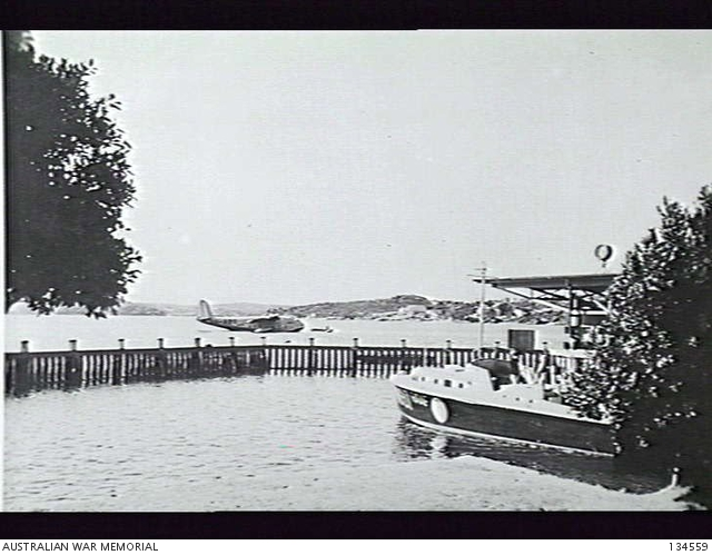 Rose Bay, NSW. Crash Launch RAAF 08-97 at its mooring. In the background is VH-ABG, a Short Empire Flying Boat S.23 (also known as a Short Empire).  AWM C255381