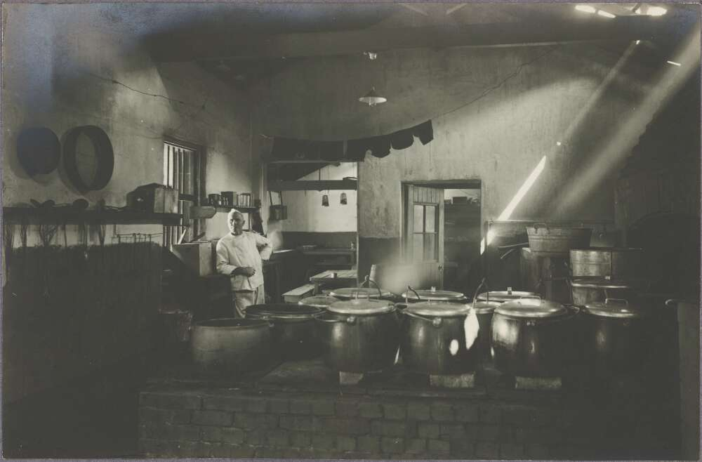 Photograph of a cook in a large kitchen