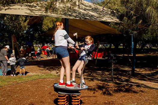 Two girls on spinner
