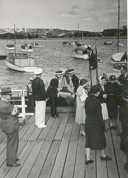 Woollahra Council in conjunction with the Royal Motor Yacht Club, carry out a National Emergency Services drill in September, 1940. Service personnel and civilians pictured on the wharf, New South Head Road, Rose Bay. <em>Woollahra Libraries Digital Archive pf004575</em>.