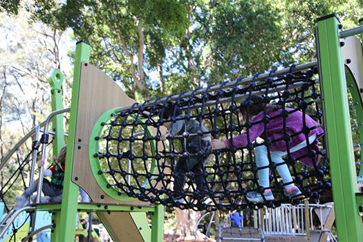 Children climbing through net