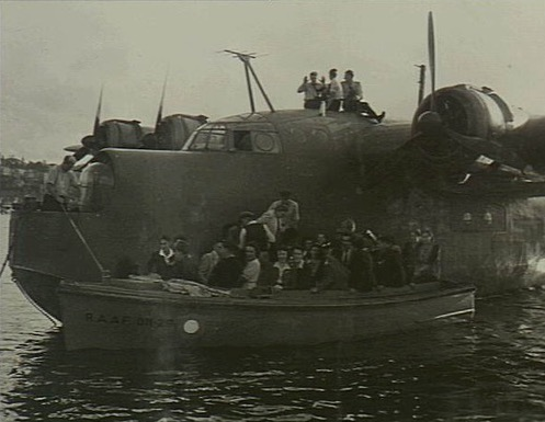 A group of civilians leaving the Short Sunderland aircraft and boarding a RAAF launch (RAAF 011-29) to be ferried back to the wharf at the Rose Bay flying boat base after being taken for a joy-flight. The aircraft, now captained by Flight Lieutenant (Flt Lt) Manger who had replaced Flt Lt M. S. Mainprize DFC, was making a tour of Australian states in support of the 3rd Victory Loan and, during each stop on the tour, took eligible subscribers of 100 pounds or more to the loan for a joy-flight. VIC1264 31 May 1945