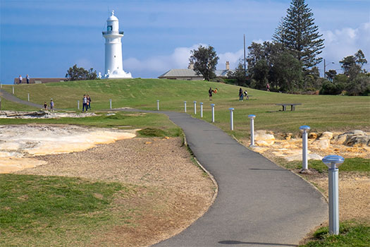 Footpath through park with Macquarie Lighthouse in Background
