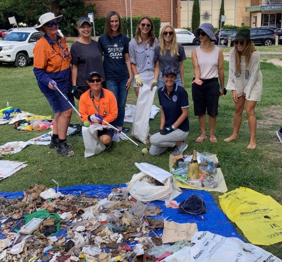 People at beach clean up