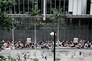 Workers gather in front of HSBC building in Hong Kong
