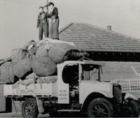 NES Volunteers standing on truck