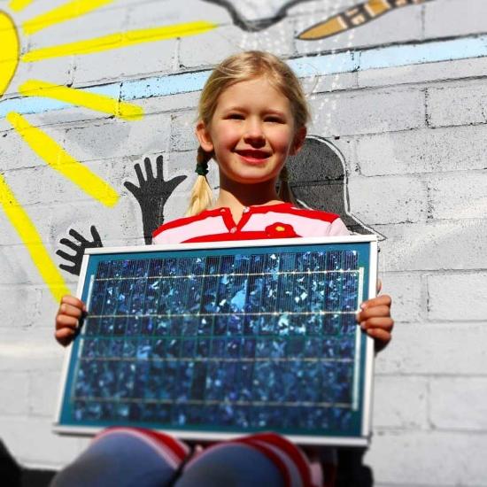 Girl holding solar panel