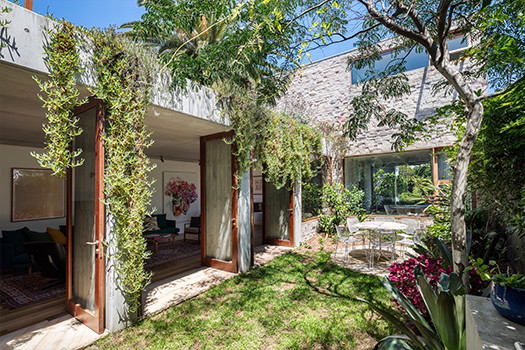 The courtyard of a home with landscaping