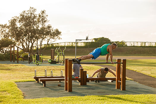 People exercising at the Christison Park outdoor gym