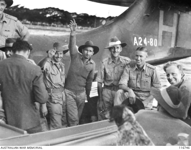 1945-09-24. Members of 8th Division, Ex-Prisoners of War of the Japanese at Changi, arrived at Rose Bay Flying Boat Base by Catalina Aircraft. Shown, a group of the ex-prisoners in the RAAF launch ready to go ashore. Australian War Memorial, 116746.