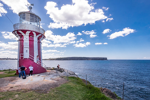 People looking out over the headland at Hornby Lighthouse