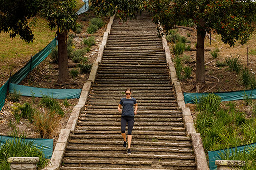 Woman running on Cooper Park stairs