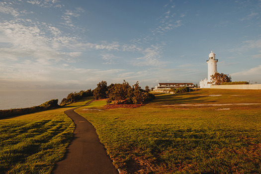 Macquarie Lighthouse with a walking path stretching in front